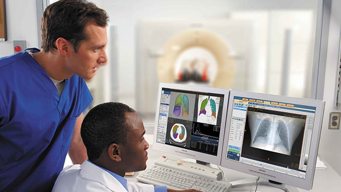 Clinicians analyzing hi resolution radiology scan images
